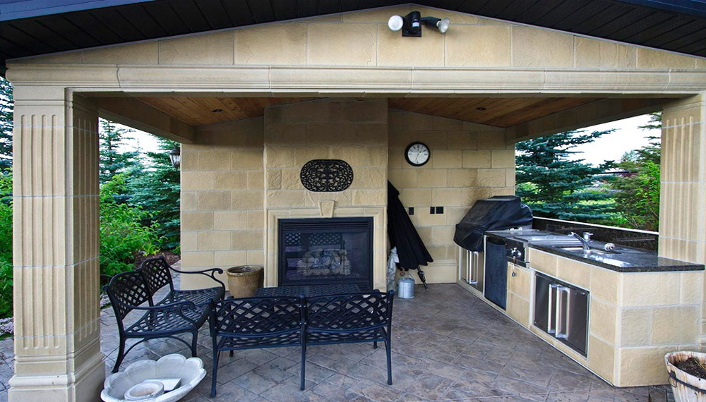 Landscaping job with outdoor fireplace and kitchen structure
