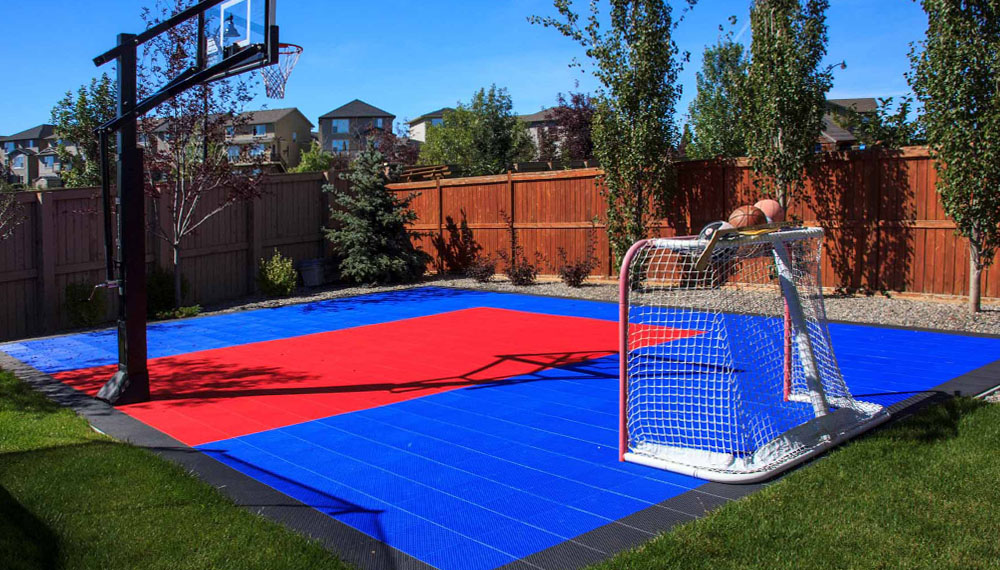 Backyard basketball court for hockey, soccer and even skating in winter