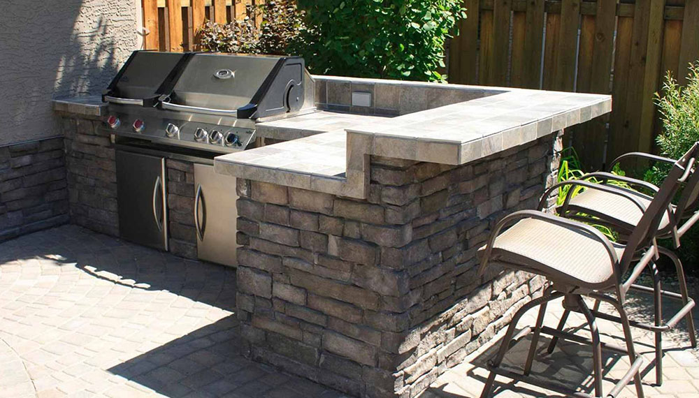 an outdoor kitchen setup with grill