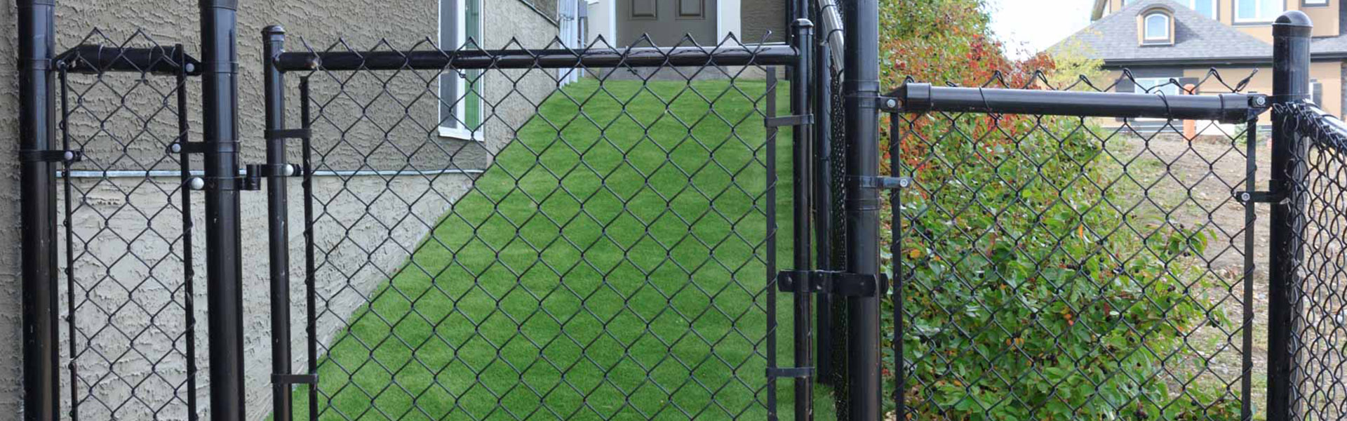 Low maintenance chain link fencing constructed to frame in a newly landscaped yard