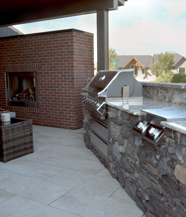 outdoor kitchen with grill, burners, refrigeration and storage