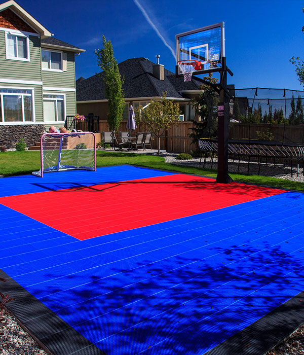 landscaping project with backyard basketball court