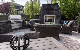 Outdoor kitchen and backyard gas fireplace