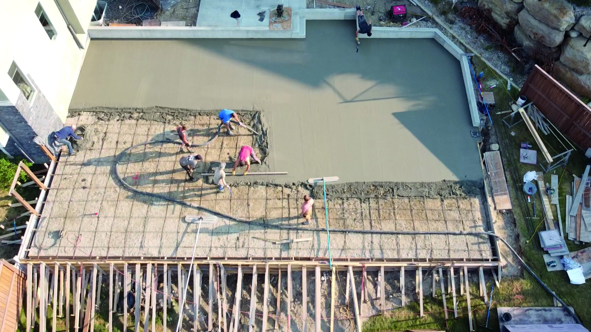 Pouring the cement foundation for the Calgary backyard sports court